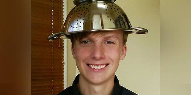 Loading A teenager was reportedly told to remove a colander from his head for a school photo. Photo / Reddit