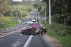 Police at the scene of a serious crash at Whakamarama. Photo / Andrew Warner
