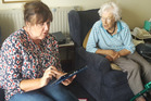 Kerikeri Retirement Village volunteer Robyn Grant giving resident Judith Donald a hand with the online census process.
