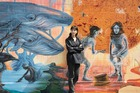 Auckland artist Erin Forsyth in front of her sustainable-themed mural at Silo Park. Photo / Brendan O'Hagan