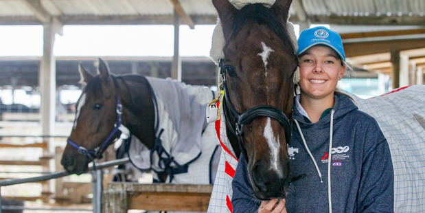 Levin eventer Abigail Long is all smiles with Enzo back in the stable after the pair copped a whopping 50 penalty points on crosscountry course today. Photo / Warren Buckland