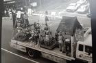 A historic parade photo shows farm animals on Queen Street. Photo / Supplied