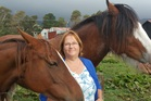 Rachael Martin with her horses at Kapiti Stables, the new horse trekking company that has taken over the lease at Queen Elizabeth Park.