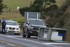 Police attend an incident involving a tipped load onto State Highway 1, Kauri, that briefly reduced traffic to one lane yesterday. PHOTO/JOHN STONE