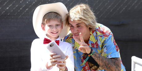 Viral internet sensation Mason Ramsey aka The Walmart Yodeling Boy, (L) and Recording Artist Justin Bieber pose for a selfie backstage during the 2018 Coachella Valley Music Festival. Photo / Getty