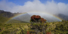 A rainbow frames the west Maui mountains.