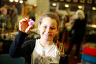 Ella Riddell holds an amethyst crystal at the weekend's Gem and Mineral Show in Whanganui. Photo / Bevan Conley