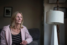 Annetta Ellis has been without power to her Titirangi home for 12 days. Photo / Michael Craig