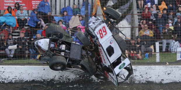 Daryl Hughes and Chris Bagrie somersault through the air after rain fell during racing at Stratford Speedway on Boxing Night.