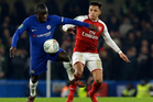 Chelsea's N'Golo Kante (left) challenges Arsenal's Alexis Sanchez during their side's League Cup semi-final first leg clash at Stamford Bridge in London this morning (NZT). Photo / AP.