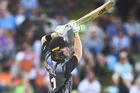 Martin Guptill hits a 6. Photo: Andrew Cornaga/ Photosport.co.nz