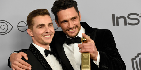 James Franco with his brother Dave after winning the award for Best Performance by an Actor in a Motion Picture at the Golden Globes. Photo / AP