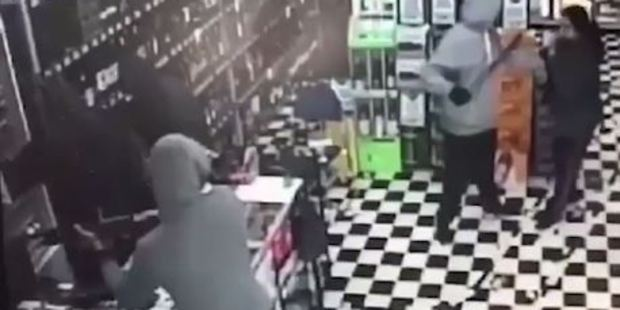 Loading Security cameras inside the Thirsty Liquor Store in Otara capture the brutal invasion as the family-owned business is ransacked and cash and cigarettes stuffed into bags and pockets. Photo / Supplied