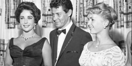 Two-faced: Fisher with Liz Taylor and wife Debbie Reynols in 1957. Photo / Supplied