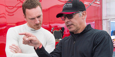 Actor Michael Fassbender, left, speaks to his driving coach as he prepares for the Ferarri Challenge practice at the Formula One Canadian Grand Prix auto race in Montreal. Photo / AP
