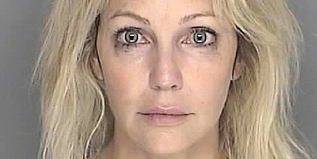 In this handout image provided by the Santa Barbara County Sheriff's Dept., actress Heather Locklear poses for a mugshot September 28, 2008 in Santa Barbara. Photo / Getty