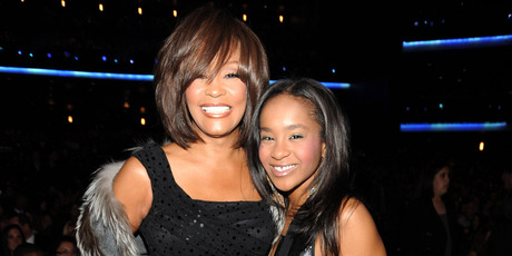 Whitney with daughter Bobbi Kristina in 2011. The 22-year-old died in 2015, six months after being found unconscious in her bathtub, in an eerie echo of her mother's demise. Photo / Getty Images