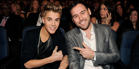 Singer Justin Bieber (L) and manager Scoot Braun pose in the audience at the 40th American Music Awards held at Nokia Theatre L.A. Live on November 18, 2012. Photo / Getty