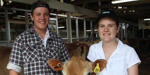 Cousins Sam Johnson and Ashleigh Stanners with Jane the cow. The cousins are the third generation to be interested in jersey breeding from the Johnson family.