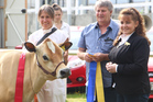 Judge Angela Parsons, her husband Peter pictured with jersey cow breeder Linda Wood.