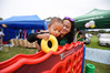 Evejah Maihi, 2, plays with the giant Connect Four with mum Mereana Waikato at Ngai Te Rangi's Whanau Day. Photo / George Novak