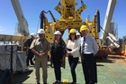 Dan Kennedy, captain of the cable-laying ship, on deck with Broadcasting Minister Clare Curran, Nicole Ferguson and Sir Eoin Edgar. Photo / Charlotte Carter
