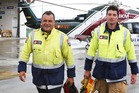 Whangarei firefighters Mark Wirihana, left and Brad Christensen return from a car crash where firefighters were deployed for the first time, aboard the Northland Rescue Helicopter. Photo / John Stone