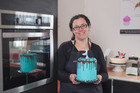 Kiwicakes owner Sandra Boston with one of her creations made using products available from Kiwicakes.