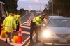 TESTING: Constable Jason Ingram checks a driver at a police checkpoint and Booze Bus on SH2, Clive. PHOTOS/DUNCAN BROWN