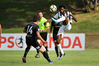 Hawke's Bay United midfielder Birhanu Taye beats Team Wellington's Jack-Henry Sinclair to the ball as referee Nick Waldron watches at Porirua Park today. Photo/Photosport