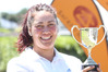 Sara Deam collects the silverware at the end of the Maraenui Open. Photo/Duncan Brown