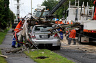 Waipa Networks linesmen extricate the Holden from the smashed pole.