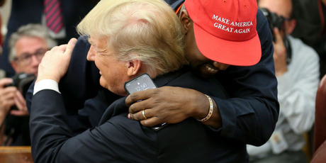 Kanye gave President Trump a hug at the end of the meeting. Photo / Getty Images