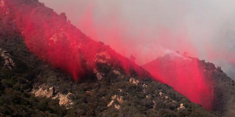 Fire retardant is dropped on the hillside Malibu. Photo / AP