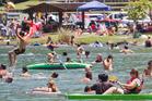 Crowds beat the heat at Tikitapu (Blue Lake) near Rotorua. Photo / Ben Fraser