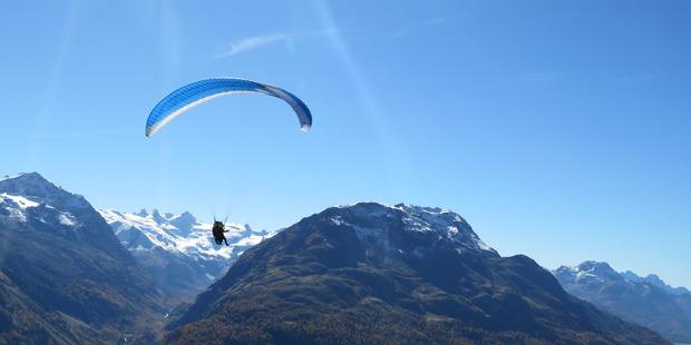 Hang-gliders at the top of Muottas Muragl.