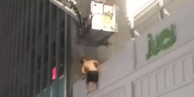 Loading The man was arrested on the roof of an Auckland's CBD building via a cherry picker. Photo / Supplied