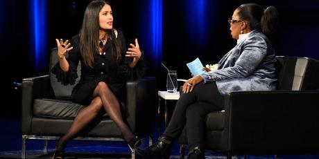 Salma Hayek Pinault and Oprah speak onstage. Photo / Getty Images