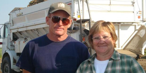 John and Meredith McLeod cover up during their potato harvest due to the sun and heat. Photo / Supplied