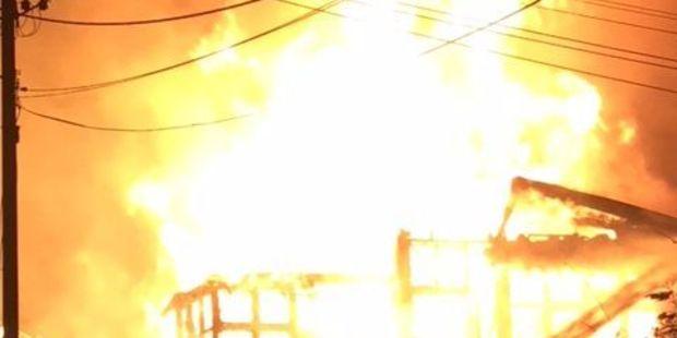 A house fire rages on the corner of Wellington Rd and Beach Rd Paekakariki. Photo: Marcel Hamann