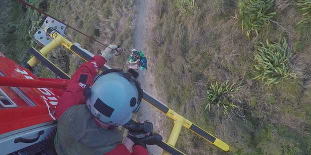 An overseas visitor is rescued by helicopter from the Paekakariki Escarpment Track. Photo: Life Flight