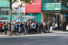 A long queue outside The Auckland City Mission as Kiwis struggle to afford Christmas last year. Photo / Doug Sherring