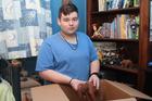 Jack Lanting packs away the items in his room, preparing for Saturday's garage sale.
