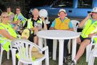 Lions club members take a breather between jobs at the Avocado Food and Wine Festival. Photo / Supplied