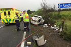 Emergency services attend to a two-car collision in Ruakaka in which two people were lucky to escape minor injuries. Photo / Supplied