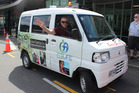 SAVING TIME: Volunteer driver Jim Bratty in the electric Shuttle Bug vehicle which is among many measures the health board has taken to reduce its carbon footprint.