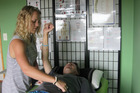 Te Awamutu's Paige West practising muscle testing on her father Steve