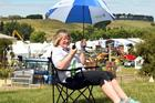 Secretary-event manager Sharon Paterson directs proceedings as stall holders prepare for the Southern Field Days at Waimumu. Photo / Stephen Jaquiery