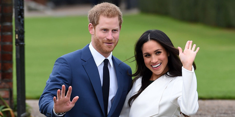 Britain's Prince Harry and Meghan Markle pose for the media in the grounds of Kensington Palace in London. Photo / AP