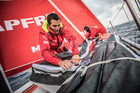 Blair Tuke packs a sail with Sophie Ciszek on board Mapfre on leg six of the Volvo Ocean Race heading for Auckland. Photo / Ugo Fonolla